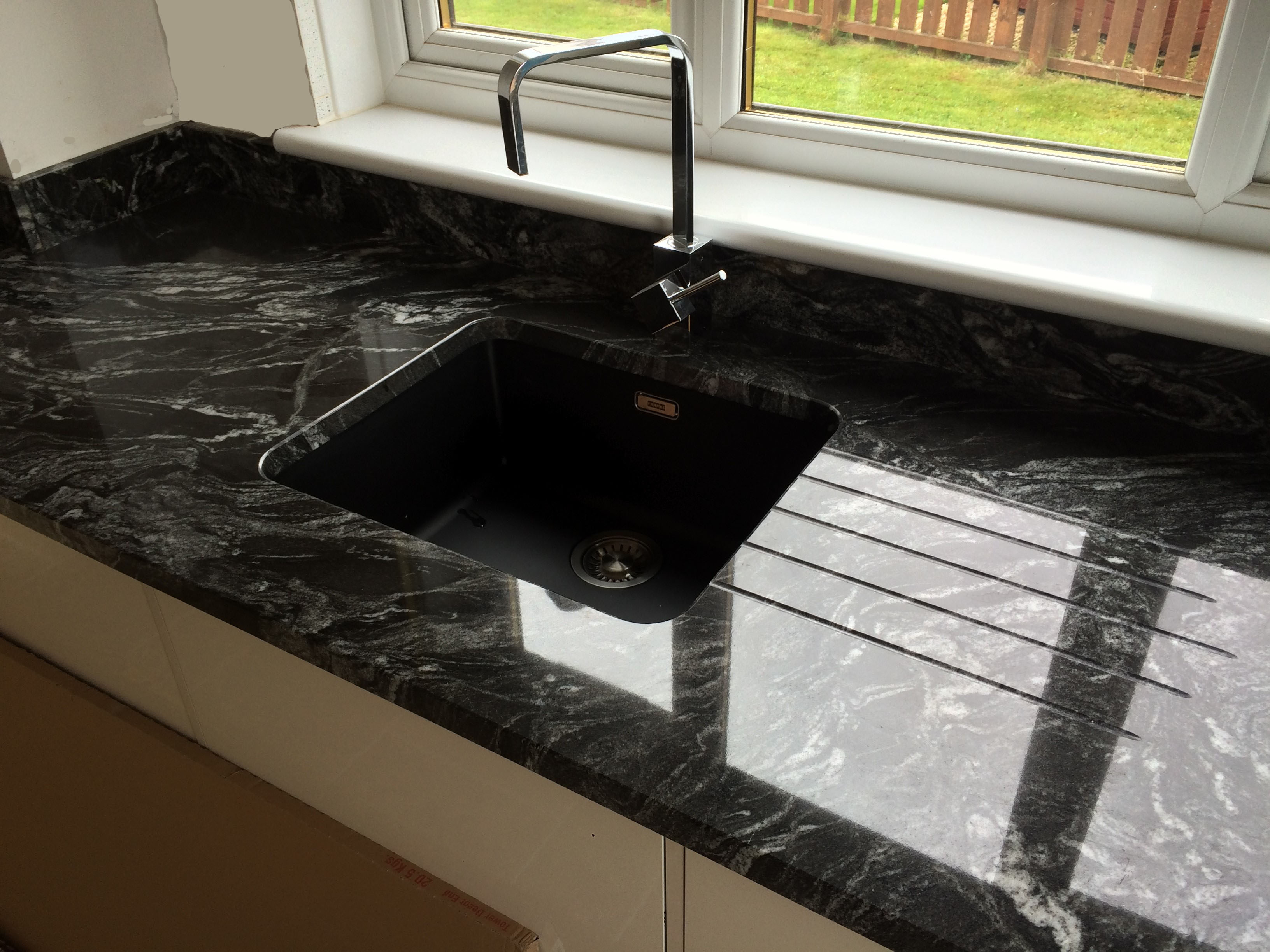 Kitchen: New Forrest Black Granite on High Gloss White Units with LED ...